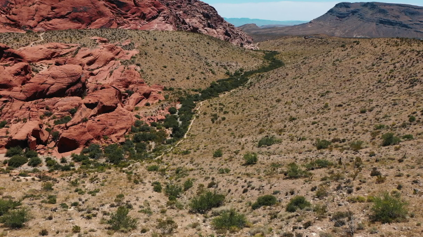 Stunning aerial landscape views of Red Rock Canyon in in Nevada's Mojave Desert near Las Vegas. | Shutterstock HD Video #1049465506