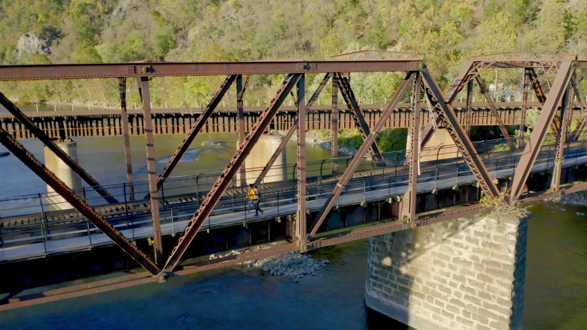 Aerial View, Couple Walking on Historical Harpers Ferry Bridge, West Virginia | Shutterstock HD Video #1049616376