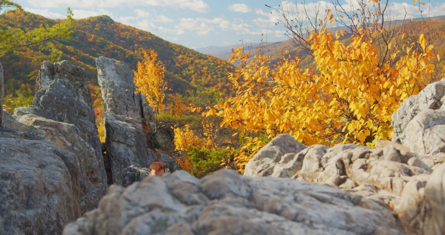 Couple Walking on Rocks at Top of Seneca Rocks, Mountain Forest Landscape | Shutterstock HD Video #1049616436