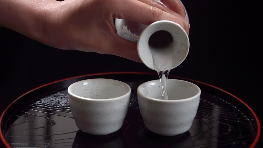 Japanese traditonal sake on black tray  | Shutterstock HD Video #1049635906