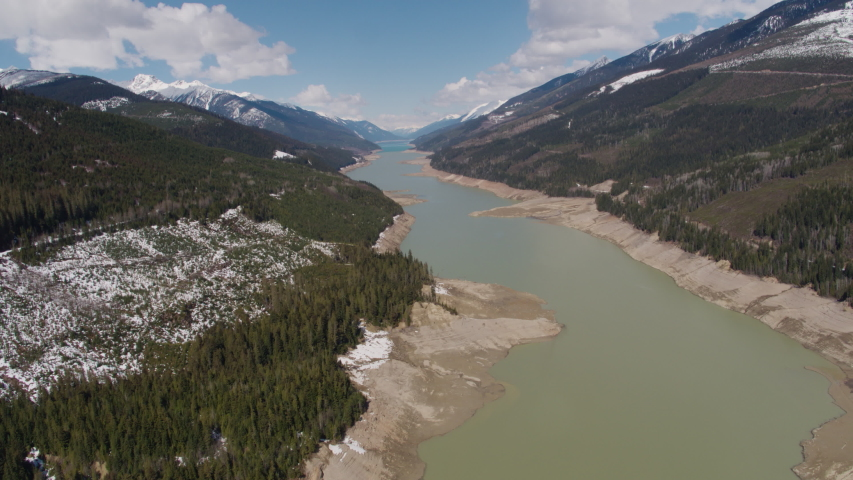 Aerial - Drone Reveal Dried Up Reservoir with Eroded Shores into Mountain Views Kinbasket BC Canada 2 | Shutterstock HD Video #1049716426