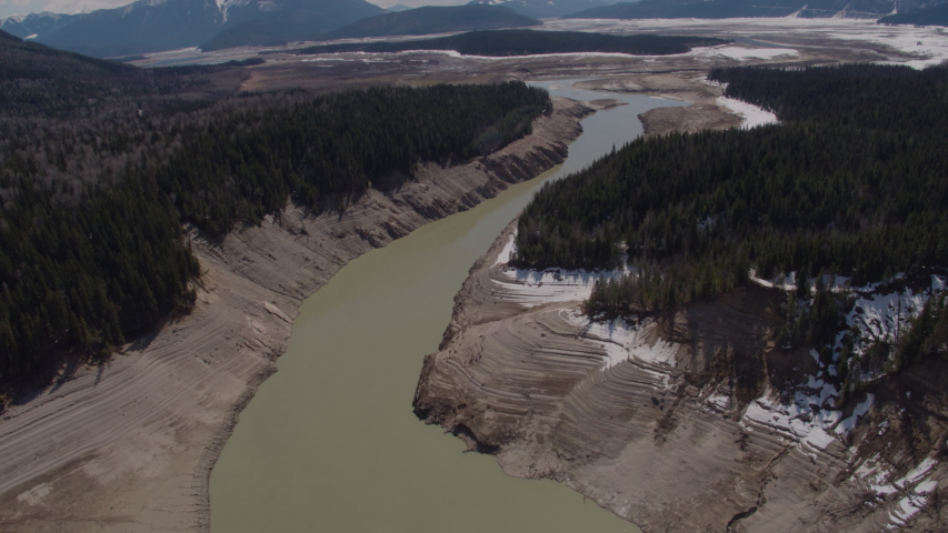 Aerial - Drone Dried Up Reservoir With Big Mountains in Background Kinbasket BC Canada 2 | Shutterstock HD Video #1049716456