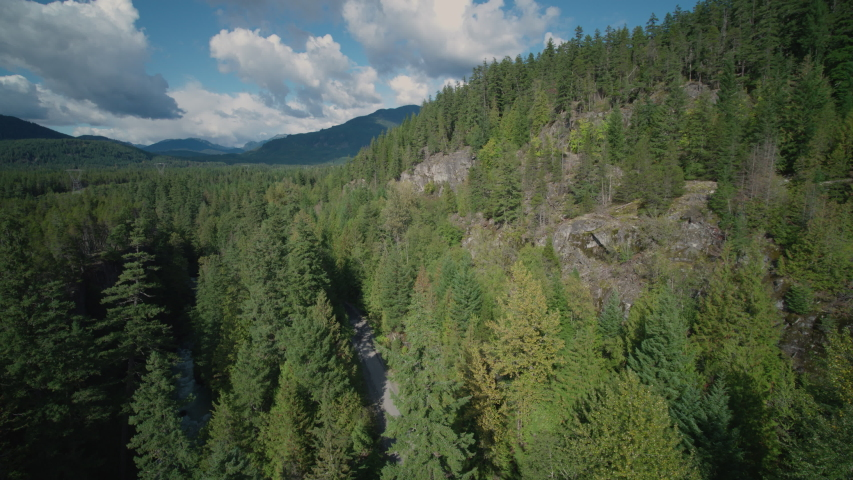 Aerial - Drone Cliffs and Forest on a Beautiful Sunny Day in Whistler British Columbia Canada | Shutterstock HD Video #1049716486