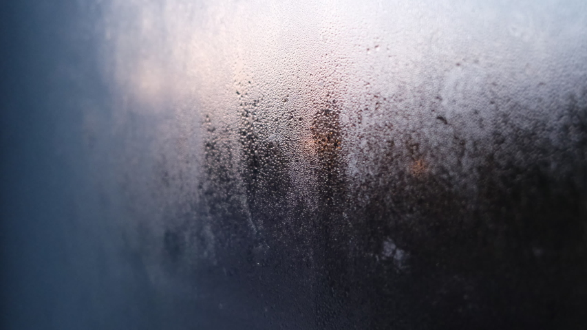 Frosty winter window with flickering street lights through the frost | Shutterstock HD Video #1049873596