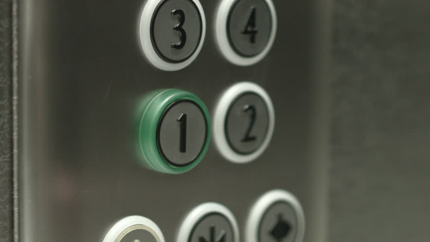 Superior Man Presses A Button The First Floor In An Elevator   HD Stock Footage Clip
