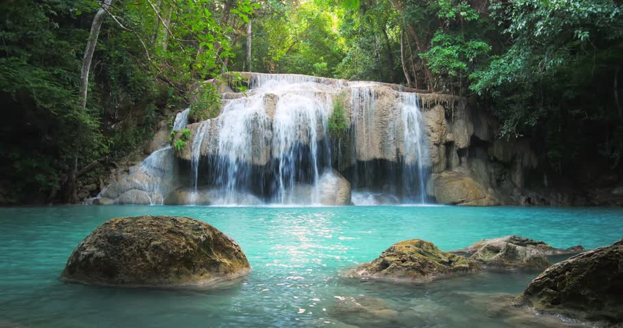Scenic waterfall in Thailand tropical forest. Beautiful nature loopable seamless background
