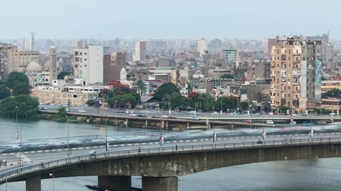 Time lapse of traffic in Cairo center, day to night transition. The 15th May Bridge / 26th July Corridor in the foreground, the Corniche in the background.