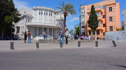 TEL AVIV - APR 10 2015:Visitors in Bialik Square in Tel Aviv, Israel.It was the home of the first city townhall  with great example of Bauhaus architecture for which Tel Aviv was named the white city