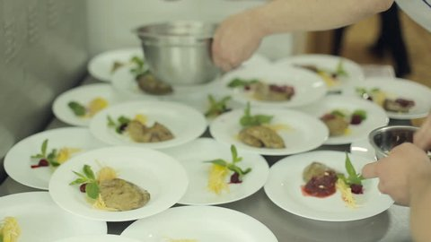 Chef prepares foie gras for catering