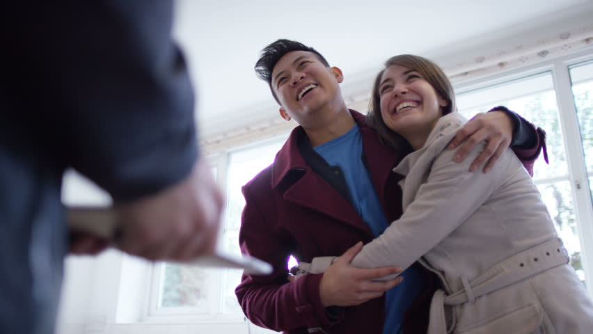 4K Young couple with real estate agent, looking at home to buy or rent