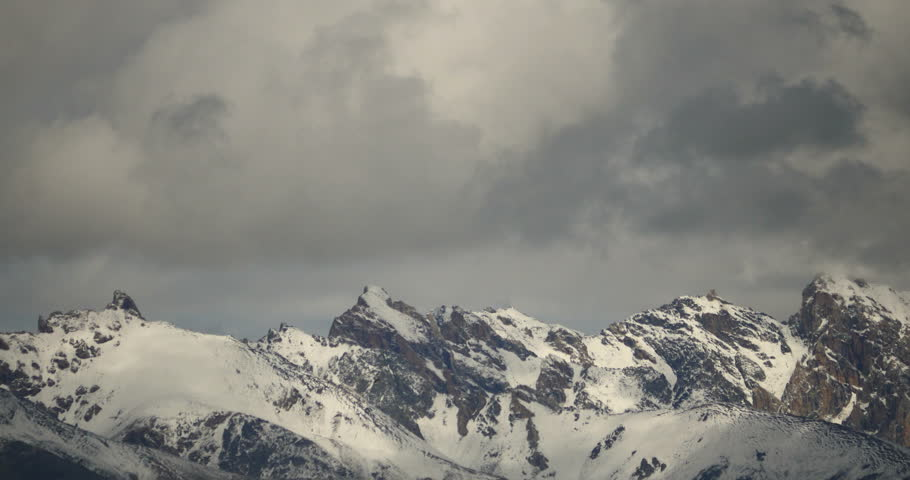 4k time lapse of clouds mass rolling over Tibet snow-Covered mountains,Danggula(Tanggula) Mountains in xizang Plateau,roof of the World. gh2_09219_4k