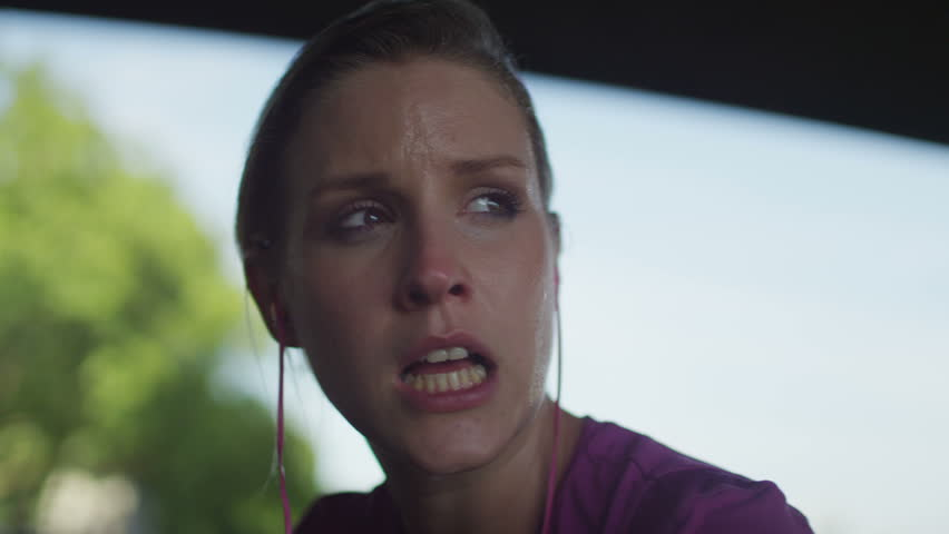 4K Female jogger out of breath looks around with a subtle smile on her face in slow motion, shot on RED EPIC | Shutterstock HD Video #10638107