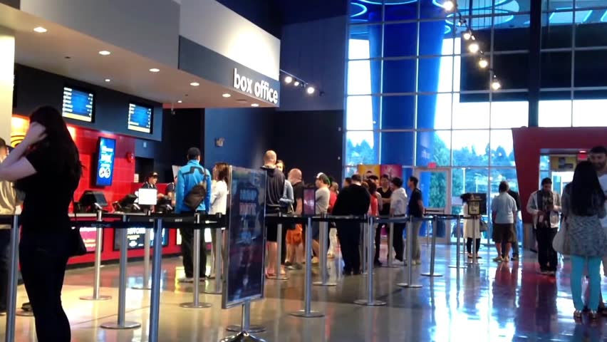 Coquitlam, BC, Canada - June 26, 2015 : People line up for buying movie ticket at cinema