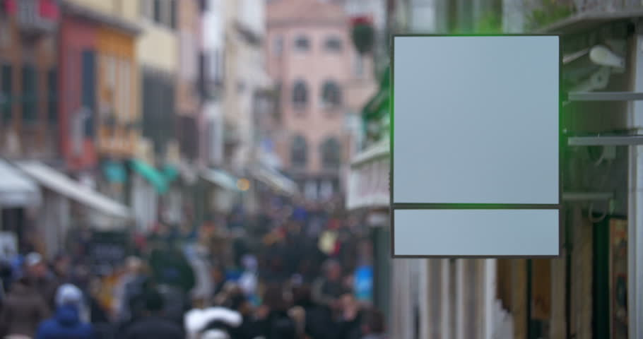 Shot of a blank shop signboard with city street crowded with people on the background. | Shutterstock HD Video #10680356