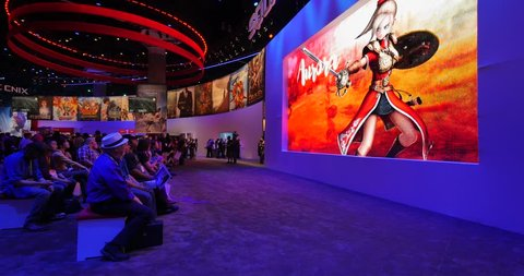 LOS ANGELES - June 16, 2015: People watching video games presentation at Square Enix booth at the E3 2015 expo. Electronic Entertainment Expo E3, is an annual trade fair for the video game industry.