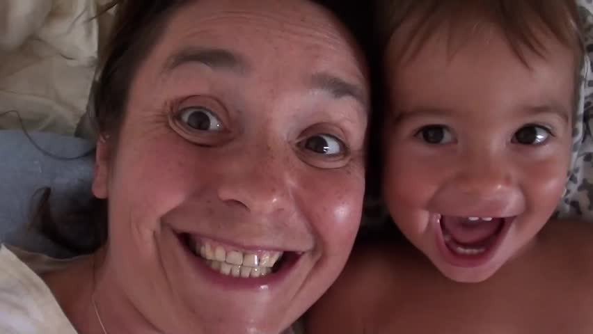 Selfie -- Mother and son monkeying around on camera, singing and kissing