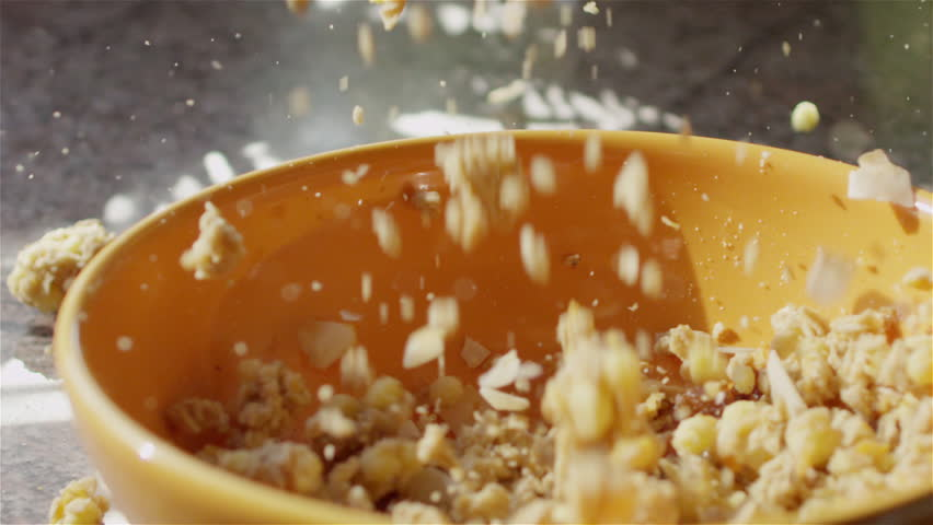 CLOSE UP: Whole grain cereal falling into bowl for breakfast | Shutterstock HD Video #10707704