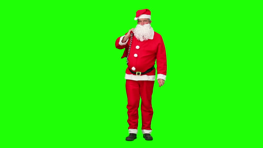 Chromakey footage of a Santa Claus holding a bag of gift and dancing
