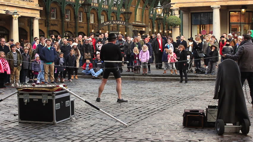 covent garden in london january 2015 people watching a street artist fettered by