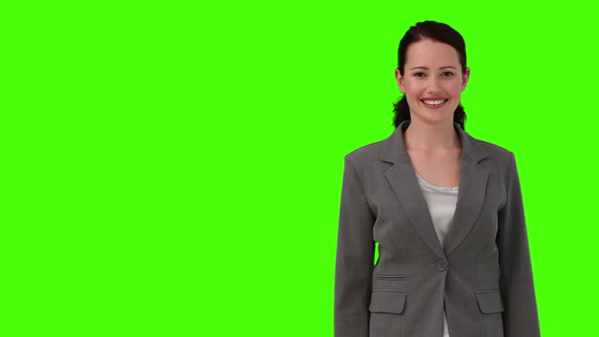 Chroma-key footage of a dark-haired woman in suit looking at the camera | Shutterstock HD Video #1074520