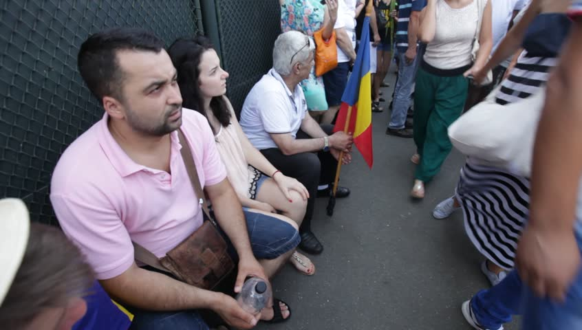 BUCHAREST, ROMANIA - JULY 12, 2015: Thousands of pro union youngsters from Republic Moldova march from Kishinev to Bucharest. Romanians welcome and join them. | Shutterstock HD Video #10745876
