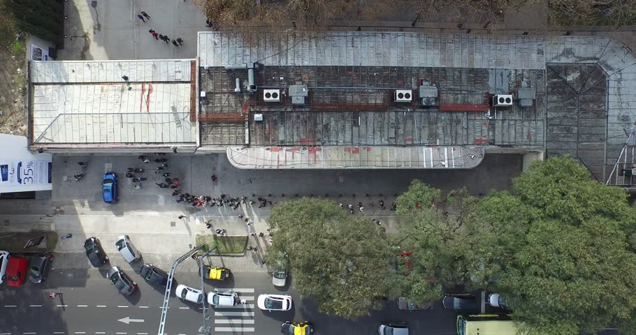 Aerial, top scene with drone of an Avenue. Camera films the traffic of the road. Cars, public transport and pedestrian flow can be percieved. Camera goes higer and moves slowly. | Shutterstock HD Video #10756676