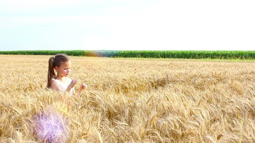 Girl playing in the wheat | Shutterstock HD Video #10756826