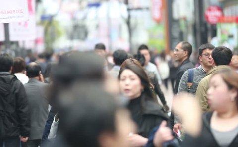 SHANGHAI - CIRCA MARCH 2015: People walking on a busy sidewalk on March 2015 in Shanghai, China