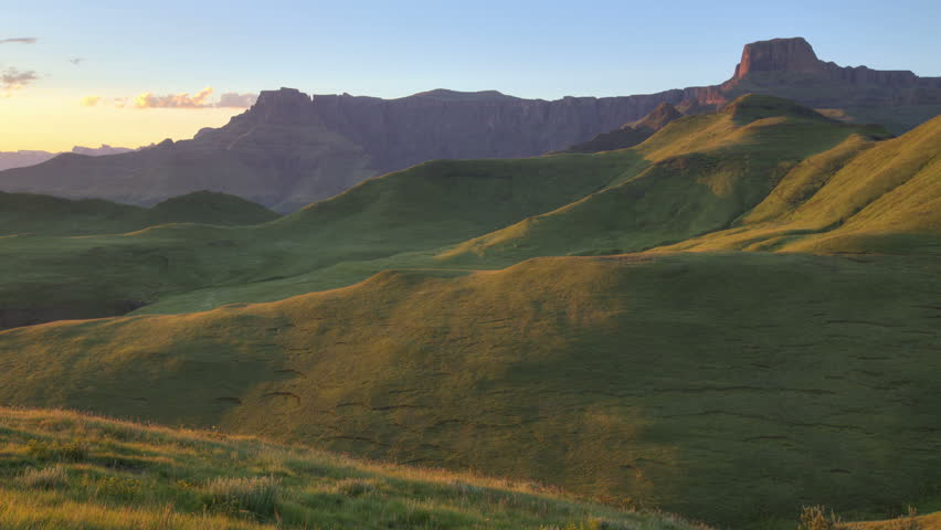 Time lapse of sunrise lighting up the Amphitheater of Drakensberg mountains, Royal Natal National Park,South Africa