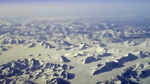 Aerial view of arctic mountains near Kluane National Park, Yukon Territory, Canada. Steady, slow motion shot.
