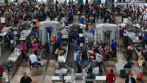 DENVER, COLORADO/USA - MARCH 1, 2015: Wide establishing TSA lines at Denver International Airport. Shot with PANASONIC FZ1000 in 4K Ultra HD.