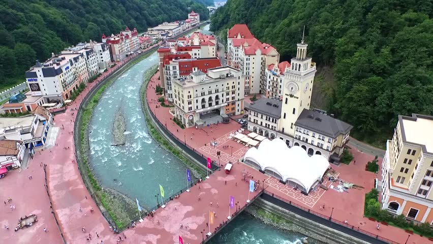 SOCHI, RUSSIA - JULY 2015: Riverside Rosa Khutor Alpine ski Resort in Krasnaya Polyana - popular center of skiing and snowboard, venue for the 2014 winter Olympics. Helicopter view.