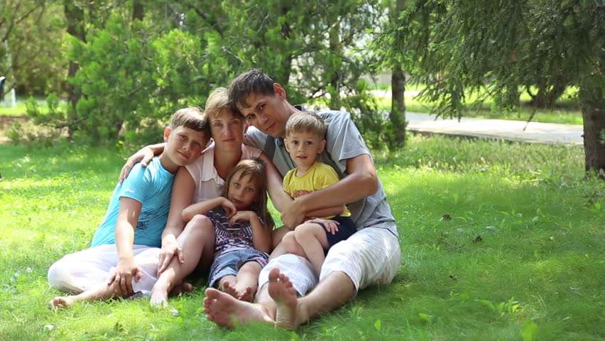 ANAPA, KRASNODAR REGION/RUSSIA - JULE 01: Mom and dad with three kids, a large family in the park on Jule 01, 2015 in Anapa  | Shutterstock HD Video #10878716