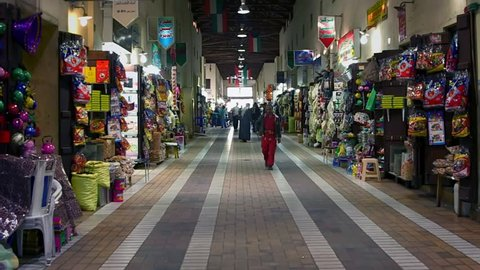KUWAIT CIRCA 2013 - People walking fast in a shopping street during the day in Kuwait City.