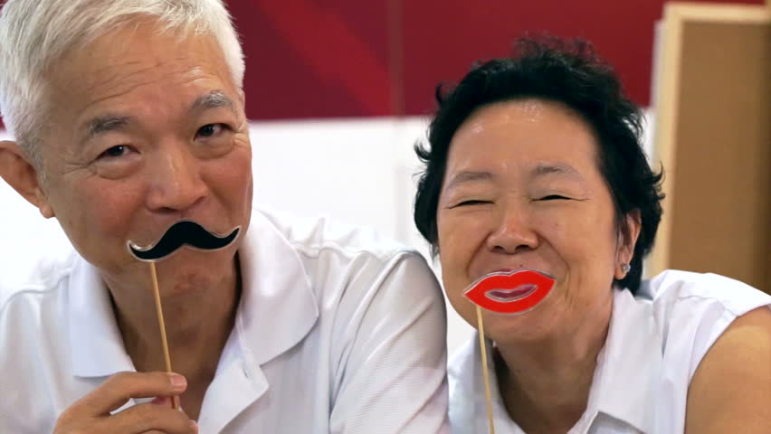 happy senior asian couple playing and have fun with humor