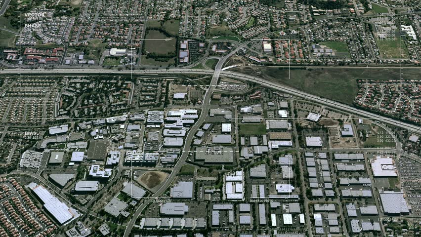 Aerial surveillance flyover of a freeway interchange. Reversible, seamless loop. Available in DCI 2K/4K, by request.