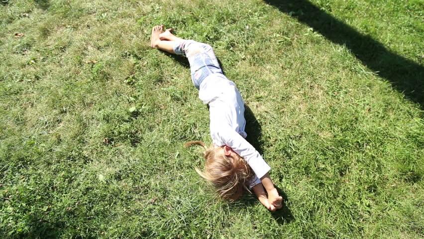 ANAPA, KRASNODAR REGION/RUSSIA - JULE 01: Girl have fun somersault on grass lawn in the park on Jule 01, 2015 in Anapa    Shutterstock HD Video #10939106