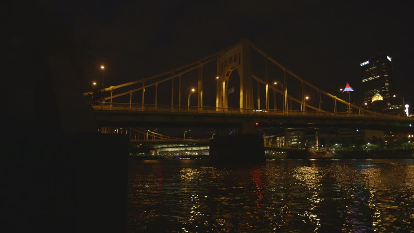 A panning shot from the Sister Bridges to the skyline in Pittsburgh, Pennsylvania at night.  (Pittsburgh PA, July 2015)
