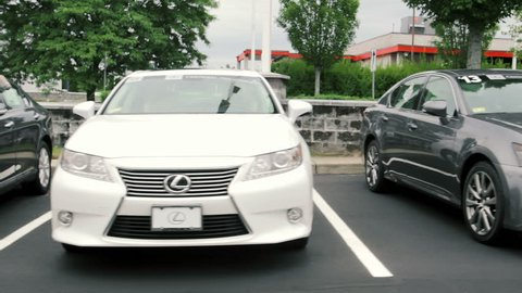 WARWICK, RI - JULY 28, 2015: Cars for sale at Lexus auto dealership lot on July 28, 2015. Lexus is the luxury vehicle division of Japanese automaker Toyota and is is sold in over 70 countries.