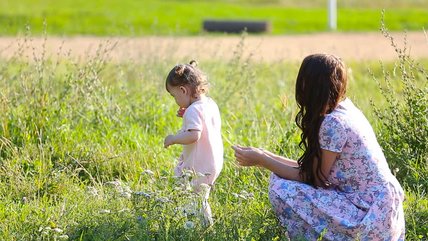 Beautiful Mother and Baby Outdoors  Stock Footage Video (100% Royalty-free)  10997036 | Shutterstock