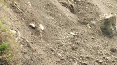 Huge Boulder Falling In Front Of The Camera , Slow Motion Tracking Shot