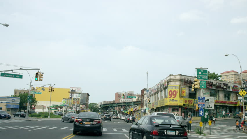 NEW YORK - JULY 12, 2015: driving down Cromwell Ave with 99 cent store from driver POV through windshield in the Bronx, 4K, NY. The Bronx is 1 of the 5 boroughs of NYC.