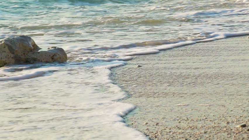 Woman walking on beach barefoot over sunset. | Shutterstock HD Video #11065496