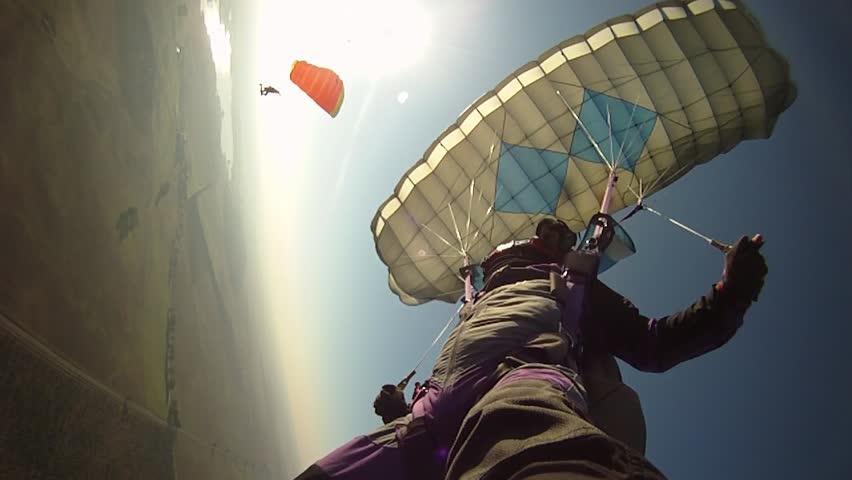 Parachutist flying