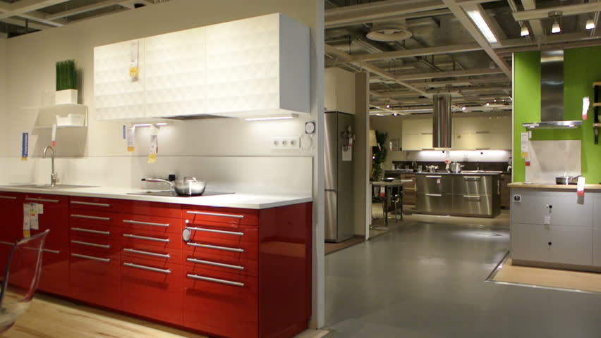 PARIS, FRANCE - CIRCA 2015: IKEA furniture store and customers browsing through its furniture, decoration and warehouse goods - panning over modern tableware