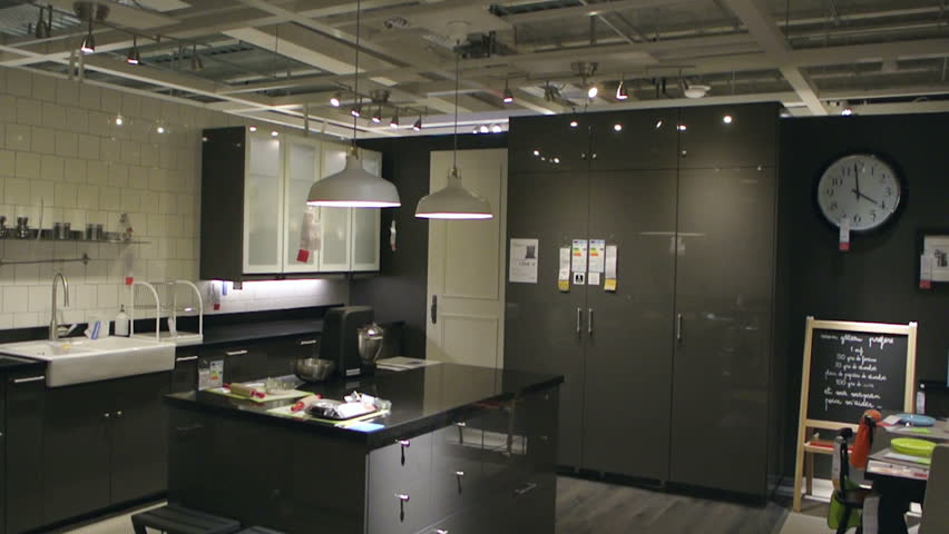 PARIS, FRANCE - CIRCA 2015: IKEA furniture store and customers browsing through its furniture, decoration and warehouse goods - panning over kitchen furniture, stoves, refrigerators and accessories   Shutterstock HD Video #11074367