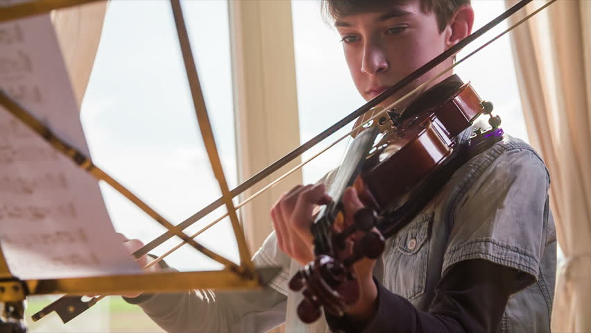Young Violinist Playing Music From Sheet On Iron Stand In Living Room At Home Bright Background Stock Footage Video 11082659