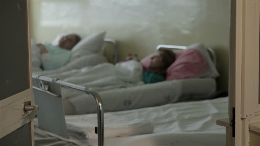 SRBIJA,KRUSEVAC,20.05.2015. Dermatology. Patients lying in hospital bed, the door is closed. Skin diseases on leg. Treatment for skin infection. Dermatological therapy. Patients lying on hospital bed. #11106806