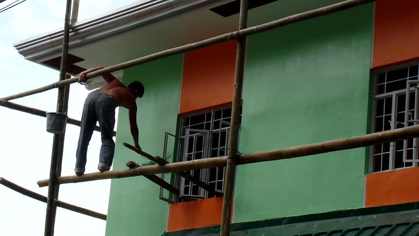 LAGUNA, PHILIPPINES - AUGUST 6, 2015: Painter Step On Bamboo ...