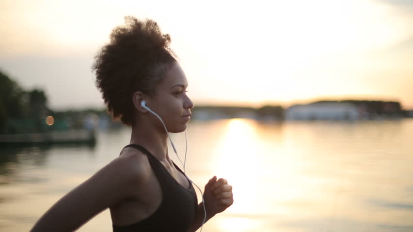 Woman running and listening to music